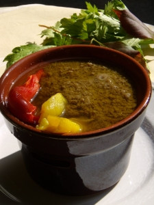 Bagna càuda, a local hot dip which is a bit like fondue but made from garlic, olive oil, anchovies and butter, spread over roasted vegetables.