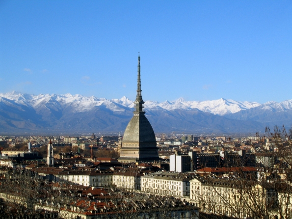 Panorama of Turin: piazzas and historic buildings lie against the backdrop of the Alps.